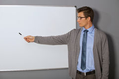 Businessman pointing at whiteboard in office Royalty Free Stock Image