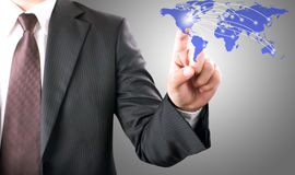 Businessman pointing on world map Royalty Free Stock Images