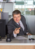 Businessman pointing. On you in bank Stock Image