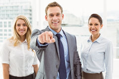 Businessman pointing at you with colleagues in office Royalty Free Stock Photos