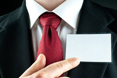 Businessman points on blank nametag Royalty Free Stock Photos
