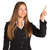 Businessman points finger up Stock Images