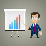 Businessman points on flipchart Royalty Free Stock Photography
