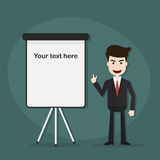 Businessman points on flipchart. Stock Photo