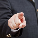 Businessman points by forefinger close up Stock Photos