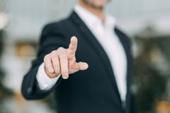 The businessman points his finger at the screen, presses and taps stock images