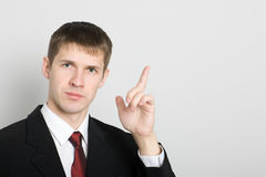 Businessman points his hand towards the. Stock Images