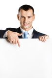 Businessman points at paper copy space Royalty Free Stock Photos