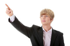 Businessman points something Stock Images