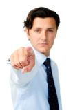 Businessman points with a straight face Stock Images