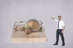 Businessman points target. Man on the grey background Stock Photography