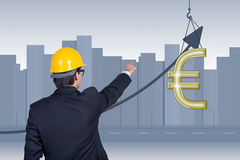 Businessman points to euro Royalty Free Stock Photo