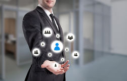 Businessman points to icon-HR, recruitment and chosen concept Royalty Free Stock Images