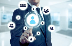 Businessman points to icon-HR, recruitment and chosen concept Stock Image