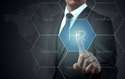 Businessman points to icon-HR, recruitment and chosen concept Royalty Free Stock Image