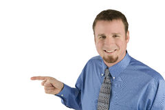 Businessman points to side. A man in a shirt and tie points to camera left Royalty Free Stock Photo