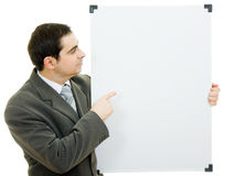 Businessman points to the white board Stock Photos