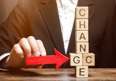 Businessman points to wooden blocks with the word Change to Chance. Personal development. Career growth or change yourself concept royalty free stock photos