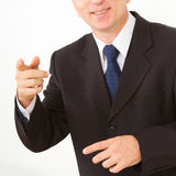 Businessman points to you. Stock Photos