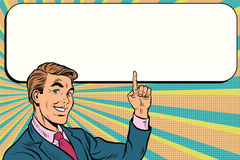 Businessman points up to copy space background. Pop art retro vector. Beautiful promo man Stock Image