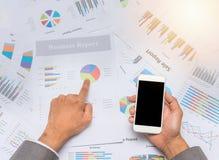 Businessman poiting at financial sheet paper Stock Photography