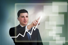 Businessman poiting to growth on a graph Stock Image
