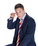 Businessman poiting two fingers Stock Photos