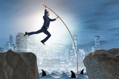 The businessman in pole vaulting concept Stock Photos