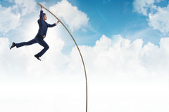 The businessman in pole vaulting concept Stock Photography