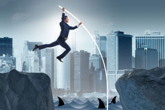 The businessman in pole vaulting concept Royalty Free Stock Image
