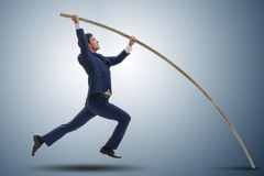 The businessman in pole vaulting concept Royalty Free Stock Images