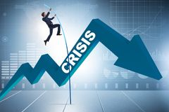 The businessman pole vaulting over crisis in business concept Royalty Free Stock Photos