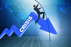 The businessman pole vaulting over crisis in business concept Stock Photo