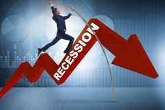 The businessman pole vaulting over crisis in business concept Stock Images