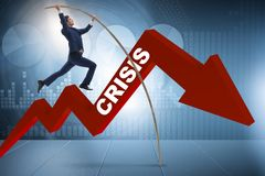 The businessman pole vaulting over crisis in business concept Royalty Free Stock Photo