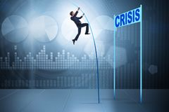 The businessman pole vaulting over crisis in business concept Stock Photography