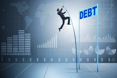 The businessman pole vaulting over debt in business concept Royalty Free Stock Photography