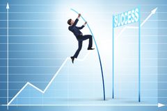 The businessman pole vaulting over towards his success career. Businessman pole vaulting over towards his success career Stock Image