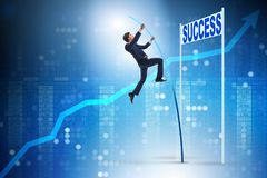The businessman pole vaulting over towards his success career Stock Image