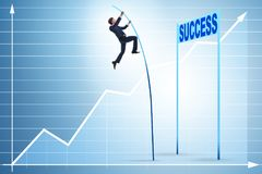 The businessman pole vaulting over towards his success career Royalty Free Stock Image