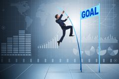 The businessman pole vaulting towards his goal in business concept Royalty Free Stock Images