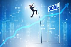 The businessman pole vaulting towards his goal in business concept Stock Photos