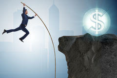 The businessman pole vaulting towards his money goal Stock Image