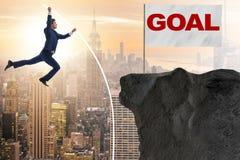 The businessman pole vaulting towards his success goal Stock Photo