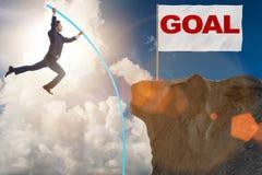 The businessman pole vaulting towards his success goal Royalty Free Stock Photos