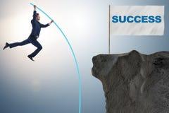The businessman pole vaulting towards his success goal Royalty Free Stock Photo