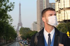 Businessman with pollution mask in Paris.  royalty free stock images