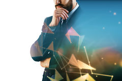 Businessman on polygonal background with copyspace Stock Image