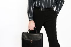 The businessman with a portfolio. The businessman holds in a hand a business portfolio Stock Images