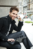 Businessman portrait. With laptop and mobile phone Royalty Free Stock Photos